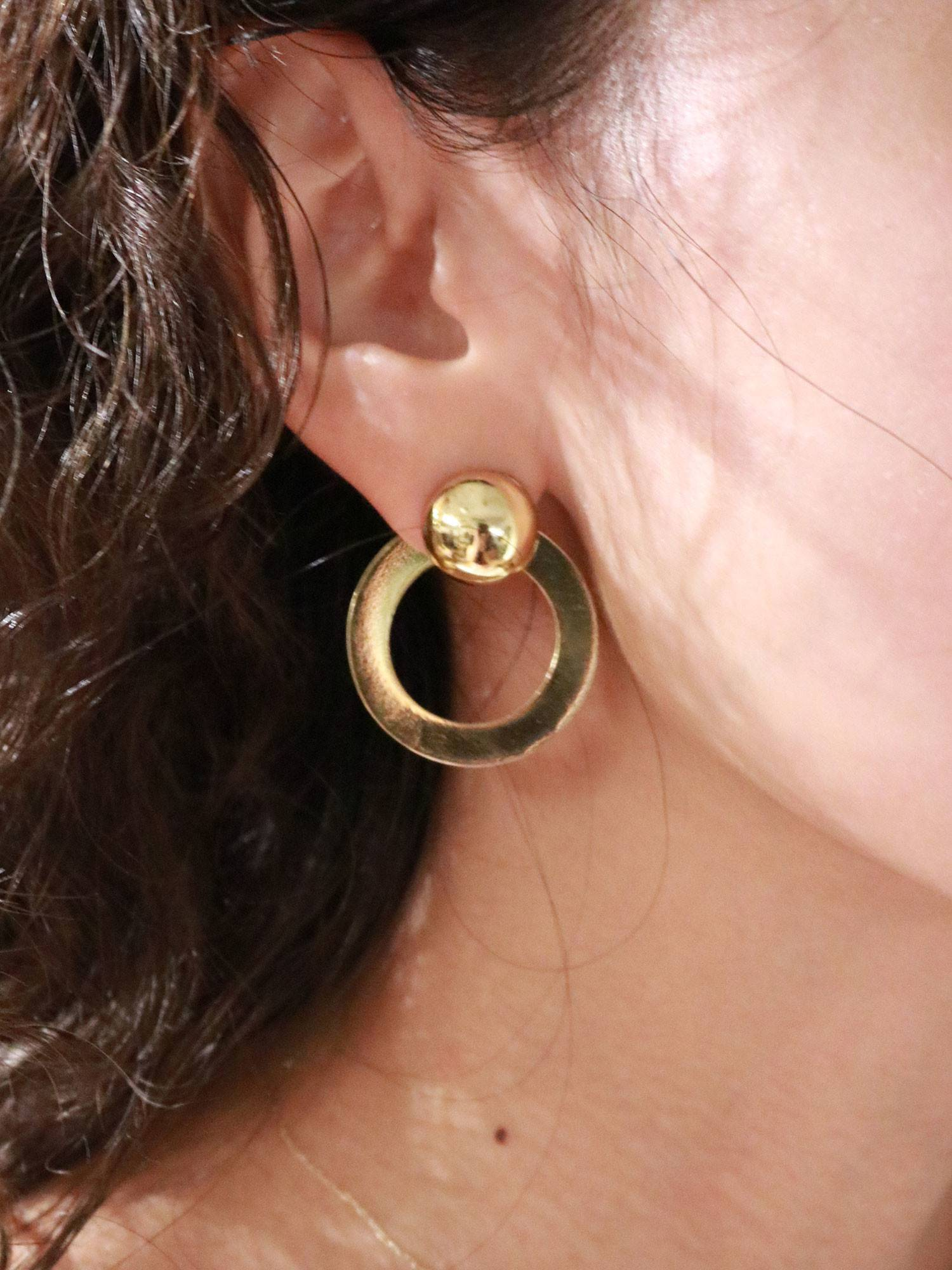 Ring motif earrings